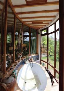 baignoire dans la serre de la chambre parentale